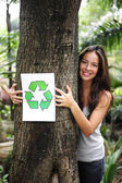 Recycling: woman in the forest holding a recycle — Foto Stock