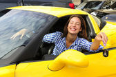 Woman showing keys of her new sports car — Stock Photo
