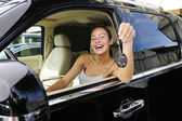 Woman showing keys of her new 4x4 off-road vehic — Stock Photo