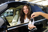 Businesswoman receiving keys of her new off-road — Stock Photo