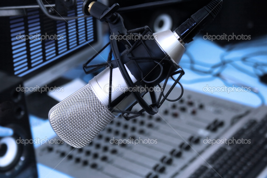 A mic in front of the control panel in broadcasting studio  Stock Photo #3310598