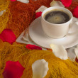 Stock Photo: Cup of coffe with rose petal