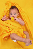 Cute Ethnic Baby Holding a Rubber Duckie — Stock Photo