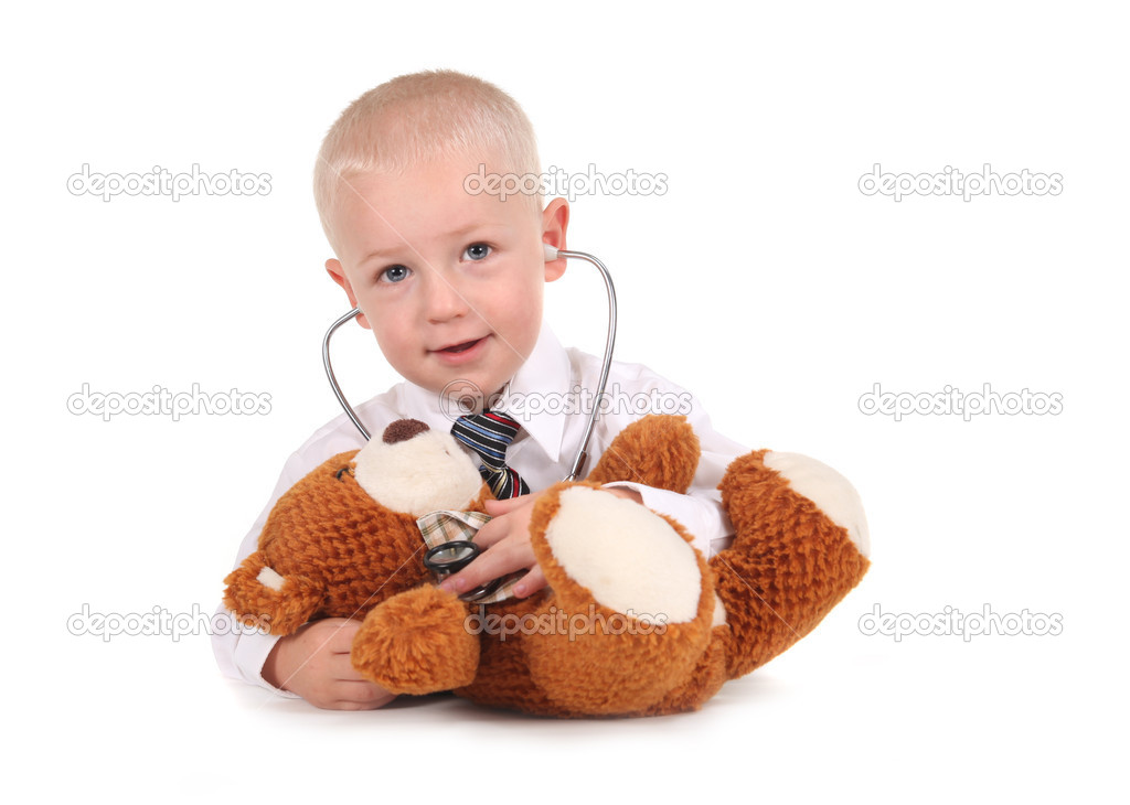 Little Boy Pretending to be a Doctor to a Teddy Bear on White — Stockfoto #2991998