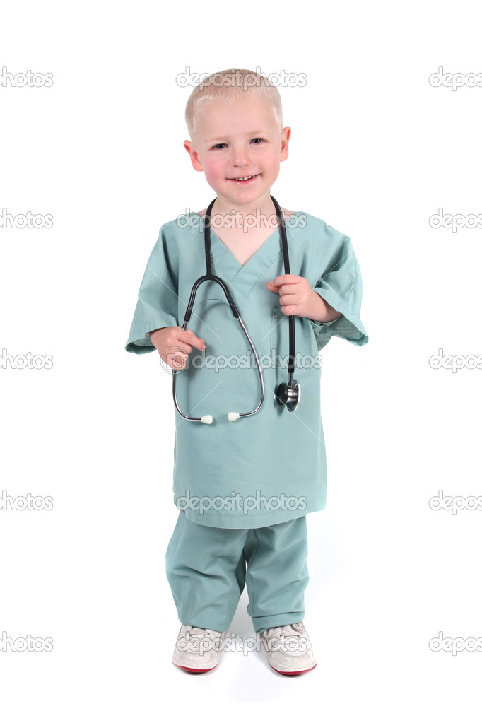 Cute Boy Wearing Scrubs Holding a Stethoscope — Stock Photo #2992029
