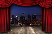Theater Stage Curtain Drapes With a Night City as a Backdrop — Stock Photo