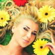 Lying in flowers - Stock Photo