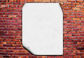 Blank poster on brick wall — Stock Photo