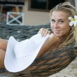 Blonde sitting in hammock — Stock Photo