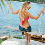 Blonde on rope swings — Stock Photo #2860823