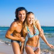Stock Photo: Two young on beach