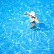 Stock Photo: Girl, white hat and swimming pool
