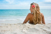 Girl with flower on the beach — Stock Photo