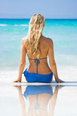 Blonde on the beach with reflection — Stock Photo