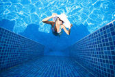 Girl, white hat and swimming pool — Stock Photo