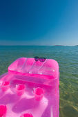 Sunglasses on raft — Stock Photo
