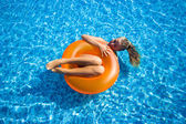 Blonde girl at swimming pool — Stock Photo