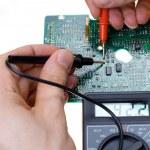 Printed circuit board and multimeter — Stock Photo