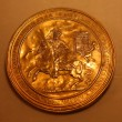 Old gold coin in vatican museum - Stock Photo