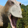 Dinosaur in the forest - Stock Photo