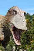 Dinosaur in the forest — Stock Photo