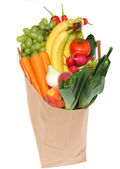 A grocery bag full of healthy fruits — Stock Photo