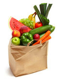 A shopping basket full of fresh produce — Stock Photo