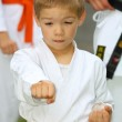 Boy in karate suit training — Stock Photo
