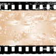 Stock Vector: Grunge filmstrip frame