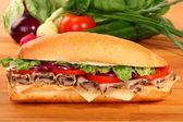 A large ham and tomato sandwich — Stock Photo