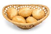 Roll with sesame in basket — Stock Photo