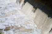Water, pouring through dam — Stock Photo