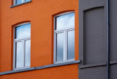 Windows on orange wall — Stock Photo