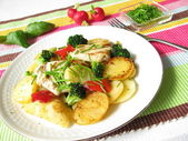 Fried potatoes with colored vegetables — Stock Photo