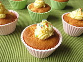 Muffins with butter cream — Stock Photo