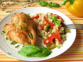 Chicken with barley grains and pepper — Stock Photo