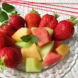 Fruit salad with melon and strawberries — Stock Photo