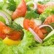 Stock Photo: Salad from tomato, cucumber and lettuce