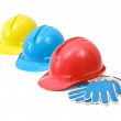 Hardhats and gloves — Stock Photo