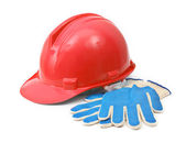 Red hardhat and gloves — Stock Photo