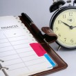 Stock Photo: Alarm clock and planner