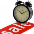 Stock Photo: Alarm clock and sale notice