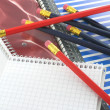 Notebooks and pencils — Stock Photo