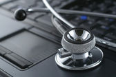 Laptop and stethoscope — Stock Photo