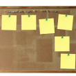 Corkboard and yellow notes — Stock Photo