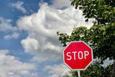 Stop sign against cloudy sky — Stock Photo