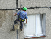 Renovation worker on a block of flats — Stock Photo