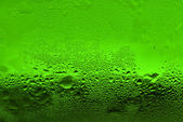 Waterdrops on green glass — Stock Photo