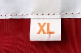 Macro of clothing label - SIZE XL — Stock Photo