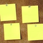Four empty yellow notes — Stock Photo